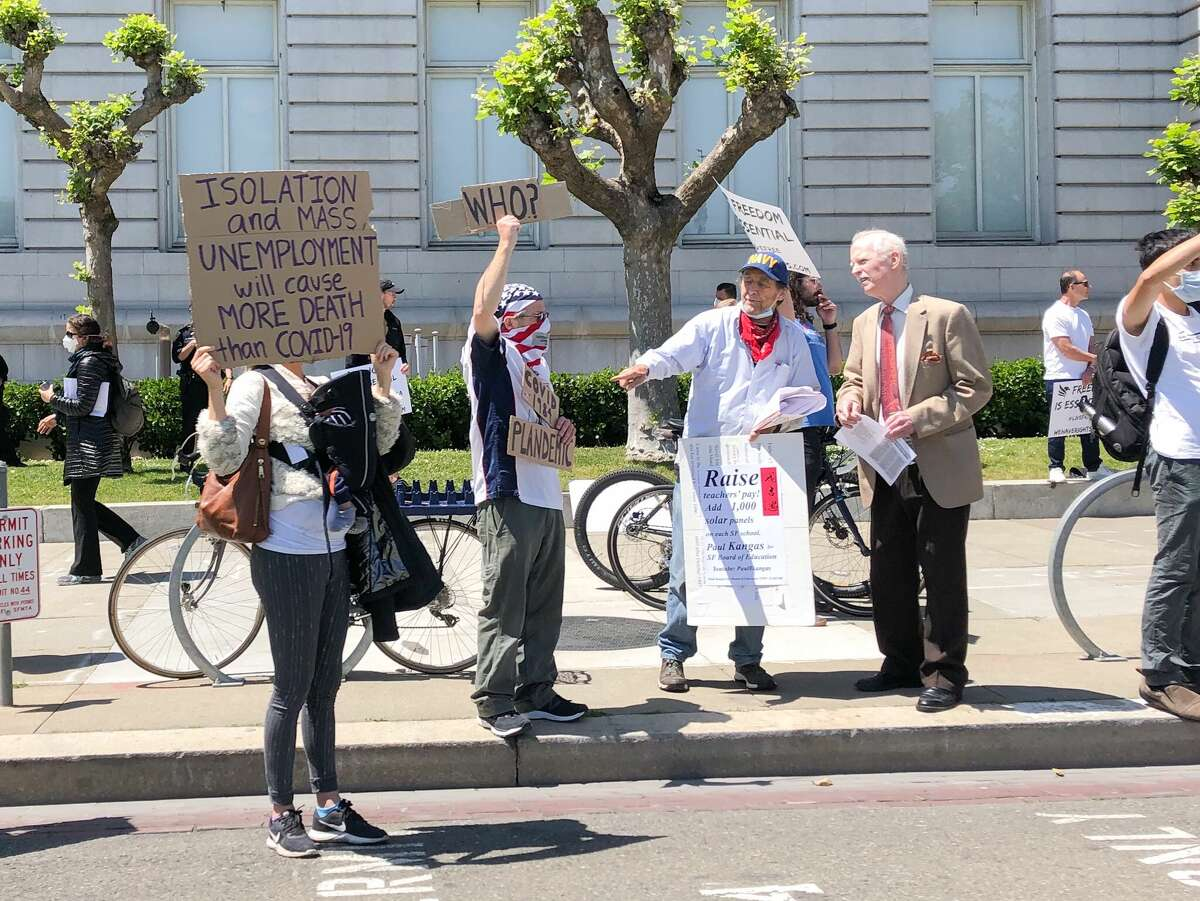 Protesters gather in front of San Francisco City Hall to protest the state's ongoing shelter-in-place order.