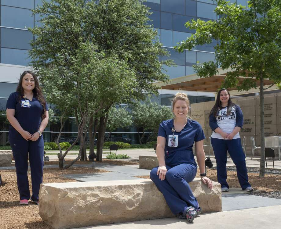 From left; Abby Villa, ER nurse at MMH, Grace Mints, ICU nurse at MMH and Erin Cardona, nurse in Total Joint Center, but moved to help on the COVID wing when Joint Center temporarily closed. 05/01/2020 Tim Fischer/Reporter-Telegram Photo: Tim Fischer/Midland Reporter-Telegram