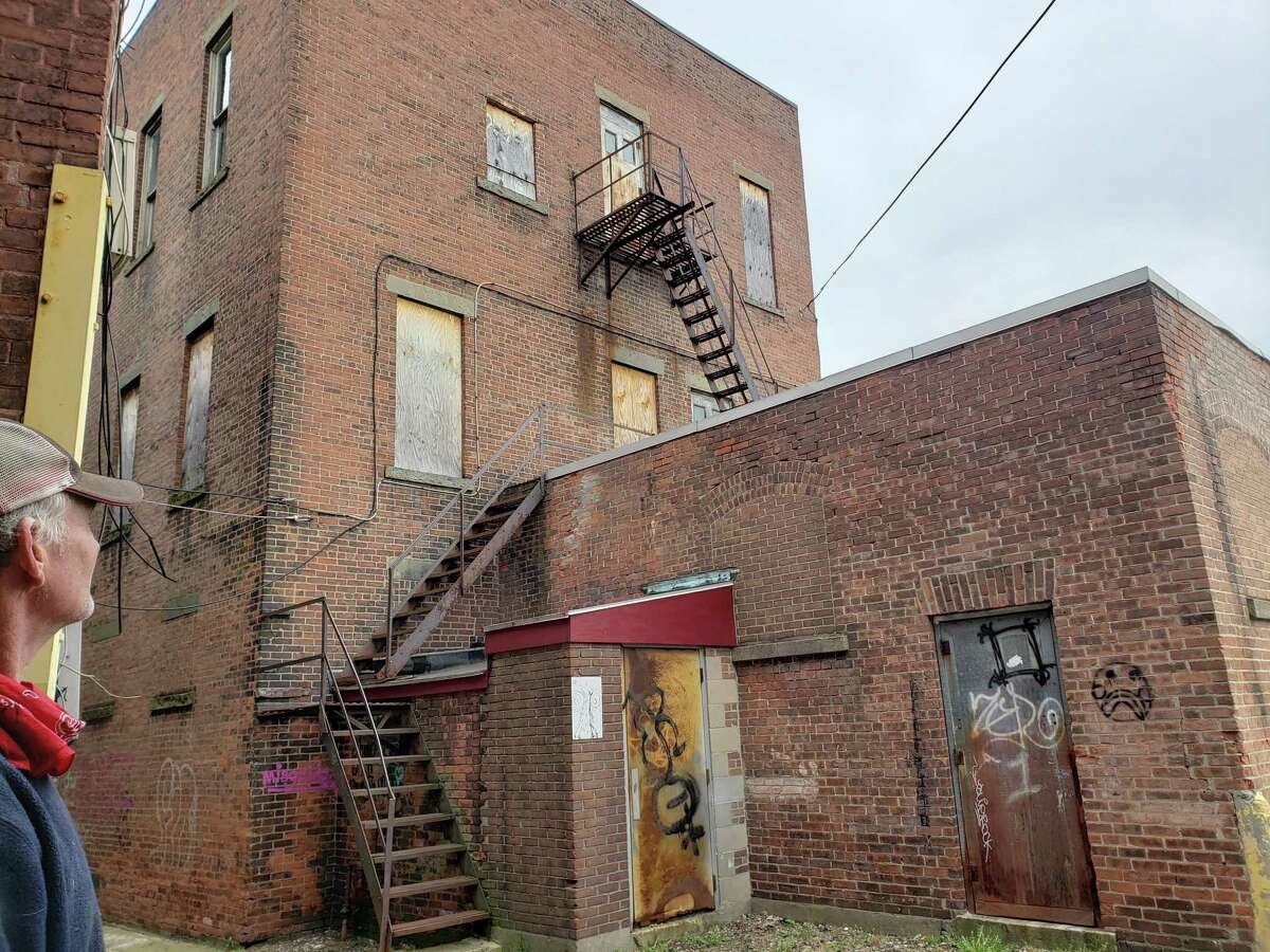The Meara building, locally known as the Howard building on Main Street, once a popular shoe and clothing store, has stood empty for years. This week, gallery owner John Noelke purchased the building, pictured here from the rear of the property.
