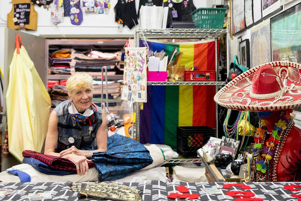 Gert McMullin poses for a portrait in the sewing room in between using leftover fabric from the famed AIDS quilt to sew face masks for the homeless and frontline workers at the quilt warehouse in San Leandro, Calif. Friday, May 1, 2020. McMullin was one of the founders of the AIDS quilt, sewing two of the first panels to memorialize friends who died in the early 1980s. Now that the second plague of her lifetime has hit, she's using that leftover fabric to sew masks for nurses, the homeless and others in need.