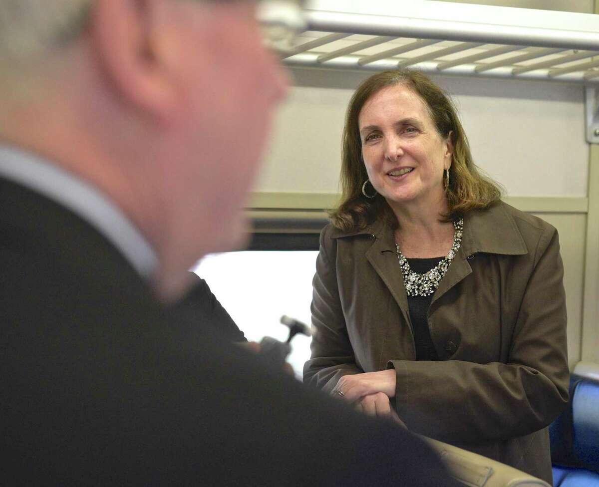 MTA Metro-North Railroad President Catherine Rinaldi listens to Bethel First Selectman Matt Knickerbocker on the 9:05 AM train to South Norwalk on Thursday, April 25, 2019, Danbury, Conn.