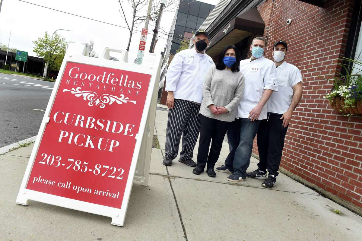 From left, Gerry Iannaccone, owner of Goodfellas restaurant, his sister Elena Fusco, owner of Bin 100, their nephew, Paul Iannaccone of Luce, owner of Ristorante Luce, and his son, Joseph Iannaccone, assistant chef at Goodfellas, are photographed in front of Goodfellas on State Street in New Haven May 1, 2020.