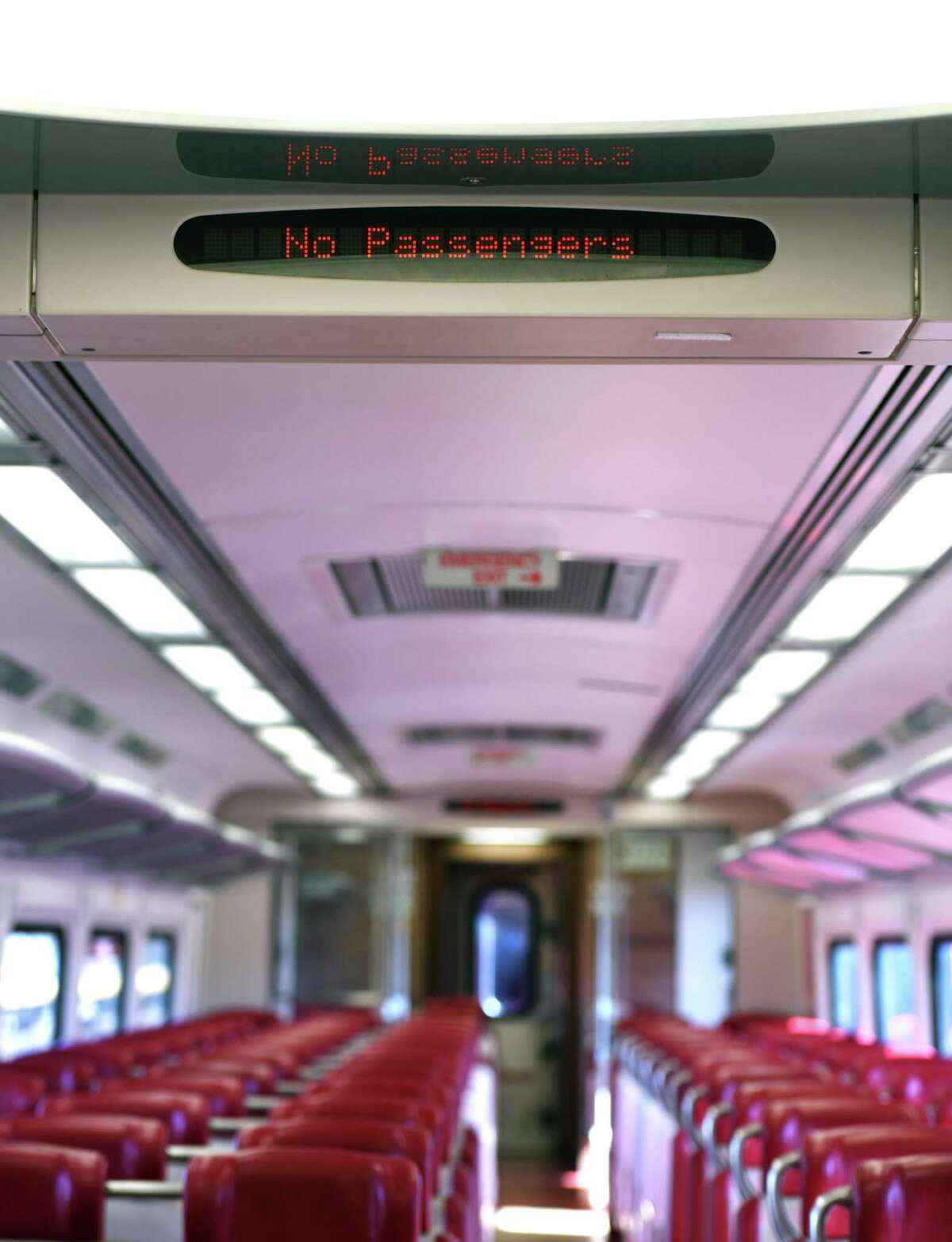 A Metro-North train car is nearly empty on the route between Greenwich and Stamford on Tuesday, March 24, 2020. Since the coronavirus outbreak, Metro-North has seen a sharp decrease in train commuters.