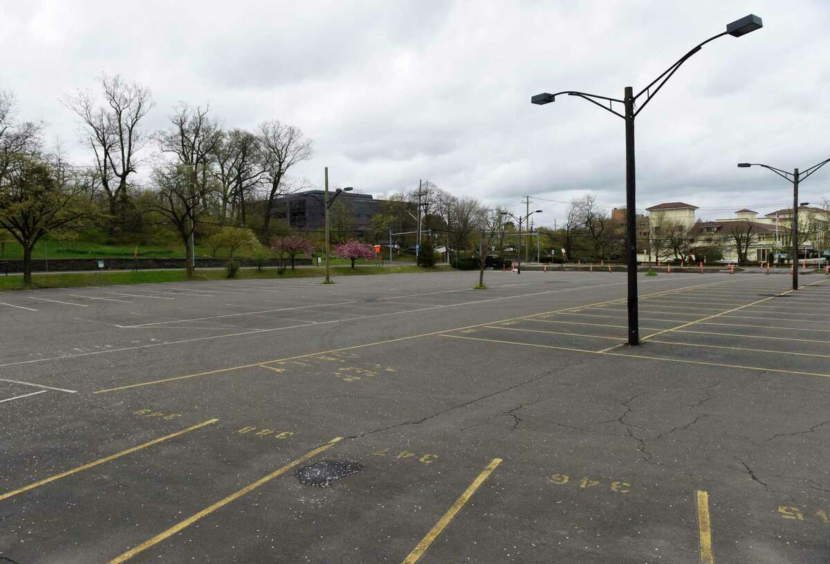 The Metro-North train station parking lot is mostly empty in Greenwich, Conn. Monday, April 27, 2020.