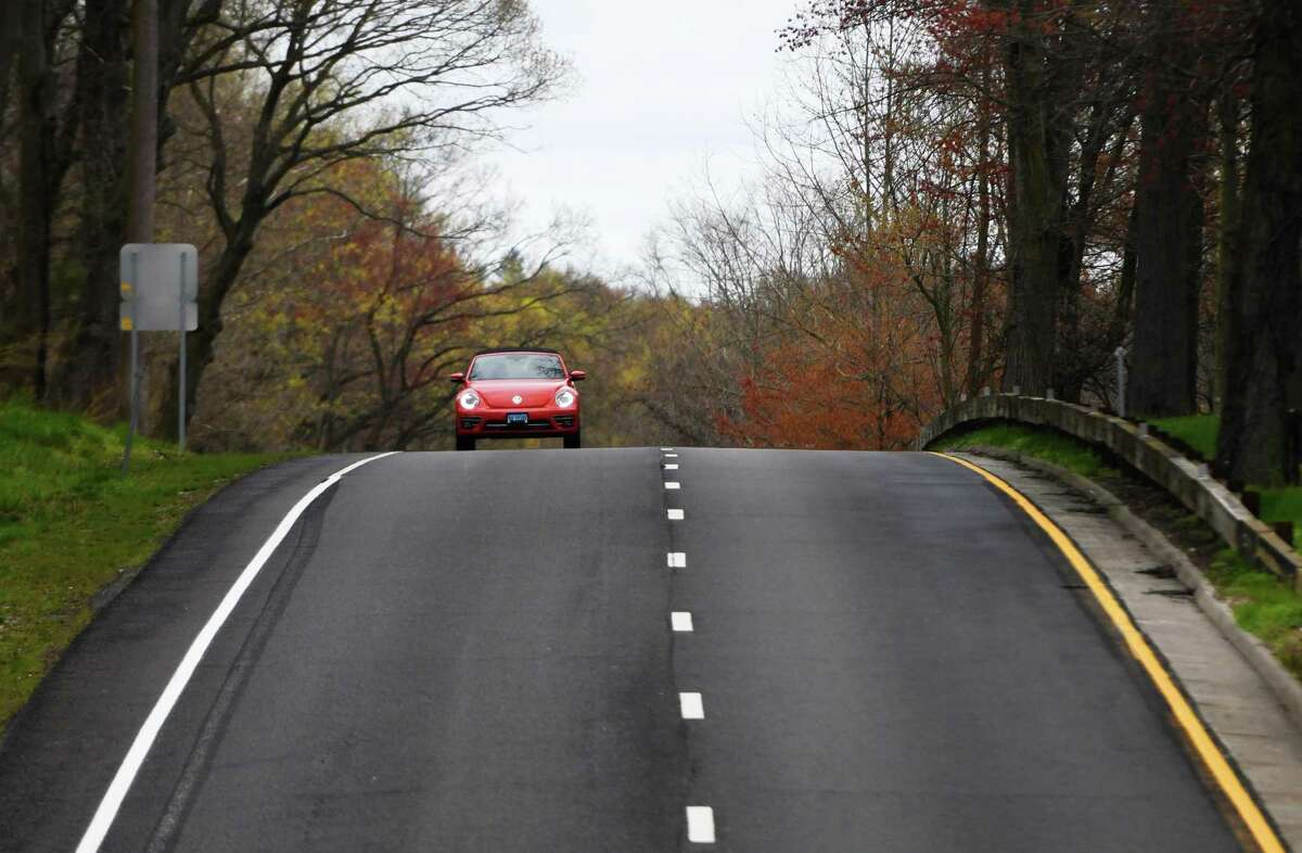 A lone car speeds down the Merritt Parkway in Greenwich, Conn. Monday, April 27, 2020.