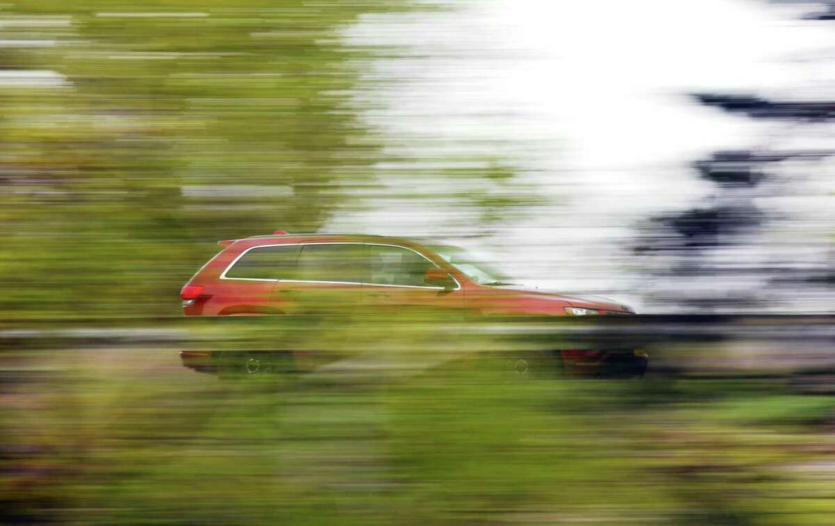 A car speeds southbound down I-95 near Exit 3 in Greenwich, Conn. Wednesday, April 29, 2020.