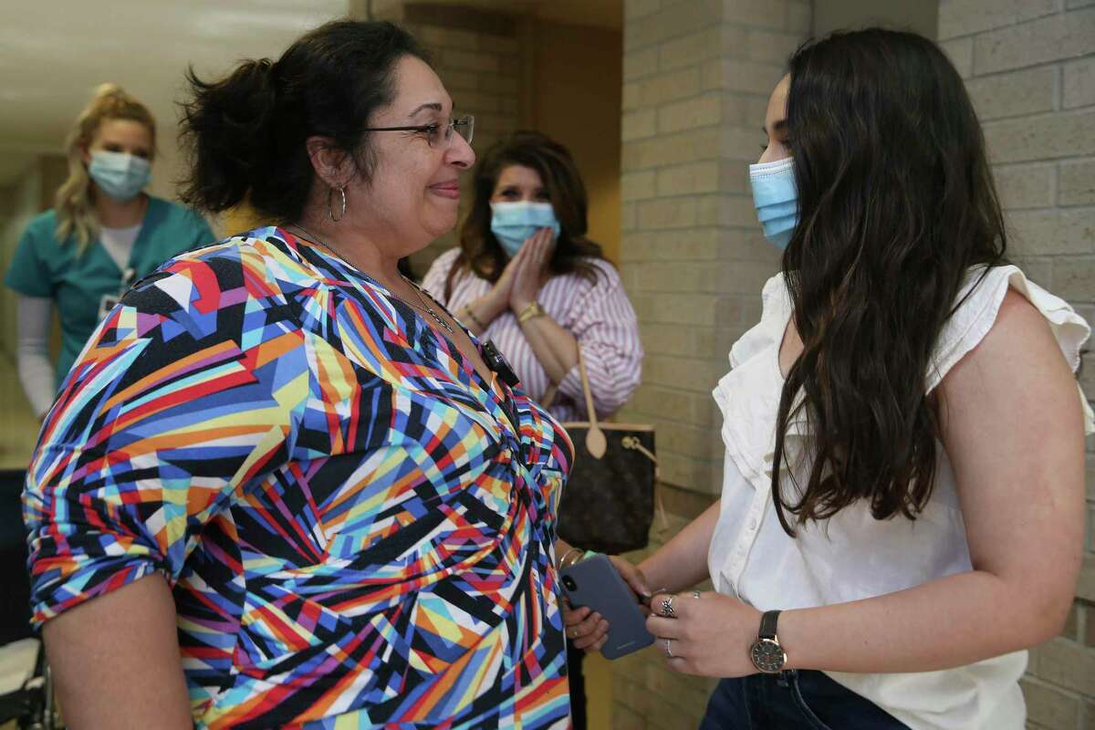 Oakley is greeted by her daughter, Jenna Faith, 18, as she is released from Northeast Baptist Hospital.