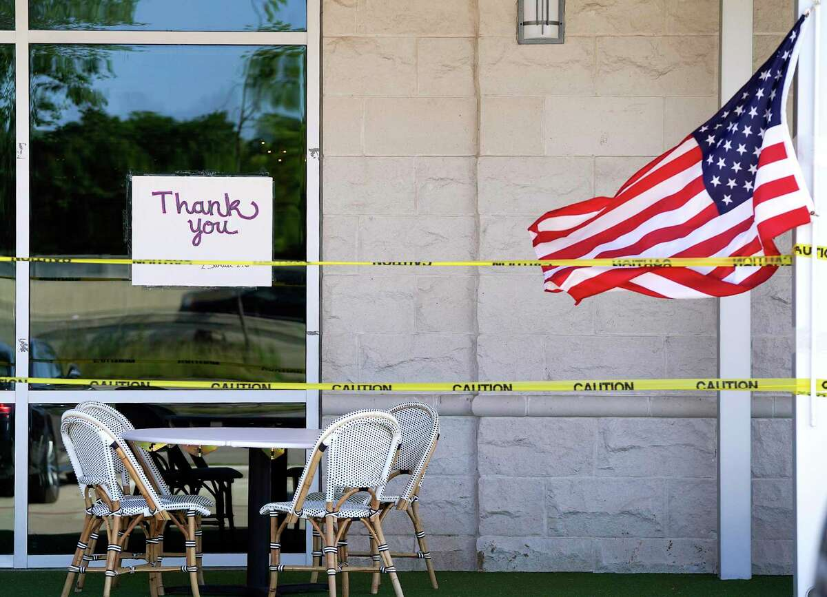 A sign in the window of Federal American Grill in Hedwig Village opened for business with social distancing practices in place on Friday, April 24, 2020.
