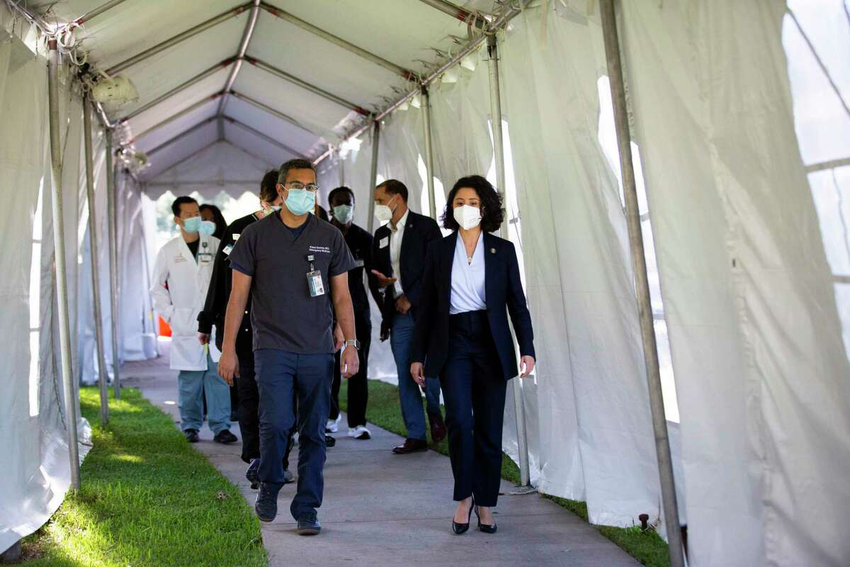 Harris County Judge Lina Hidalgo and medical doctor Kunal Sharma enter an area of the Lyndon B. Johnson Hospital where patients are evaluated for COVID-19 on Thursday, April 30, 2020, in Houston.