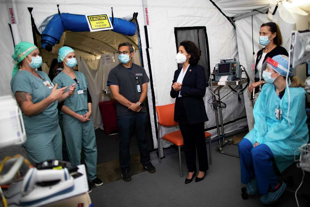 Harris County Judge Lina Hidalgo listens to Lyndon B. Johnson Hospital staff during a visit to the hospital on Thursday, April 30, 2020, in Houston.