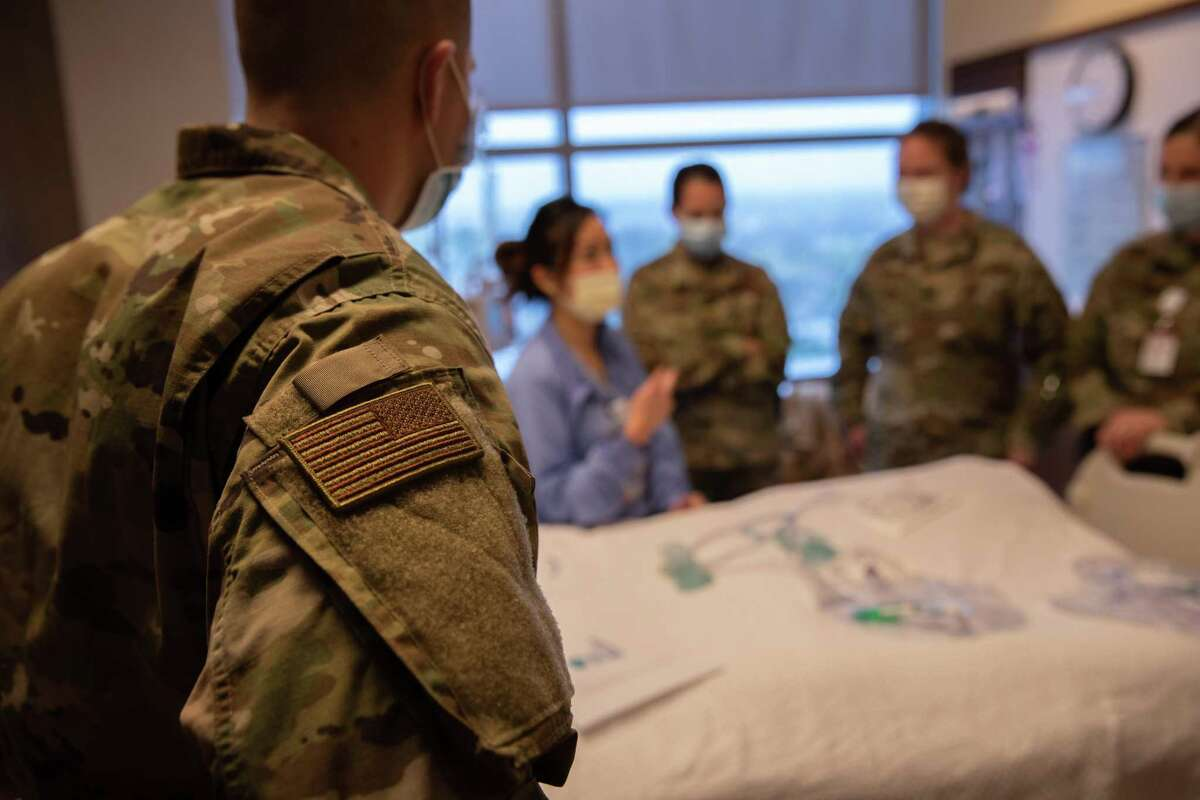 STAMFORD, CONNECTICUT - APRIL 24: (EDITORIAL USE ONLY) U.S. military medical personnel, including U.S. Army reserve and Connecticut National Guard train with Stamford Hospital medical staff on April 24, 2020 in Stamford, Connecticut. Like many hospitals across the United States, Stamford Hospital opened additional ICUs and have been augmented by military medical personnel to deal with the heavy patient load. Stamford, with it's close proximity to New York City, has the highest number of coronavirus patients in Connecticut. (Photo by John Moore/Getty Images)