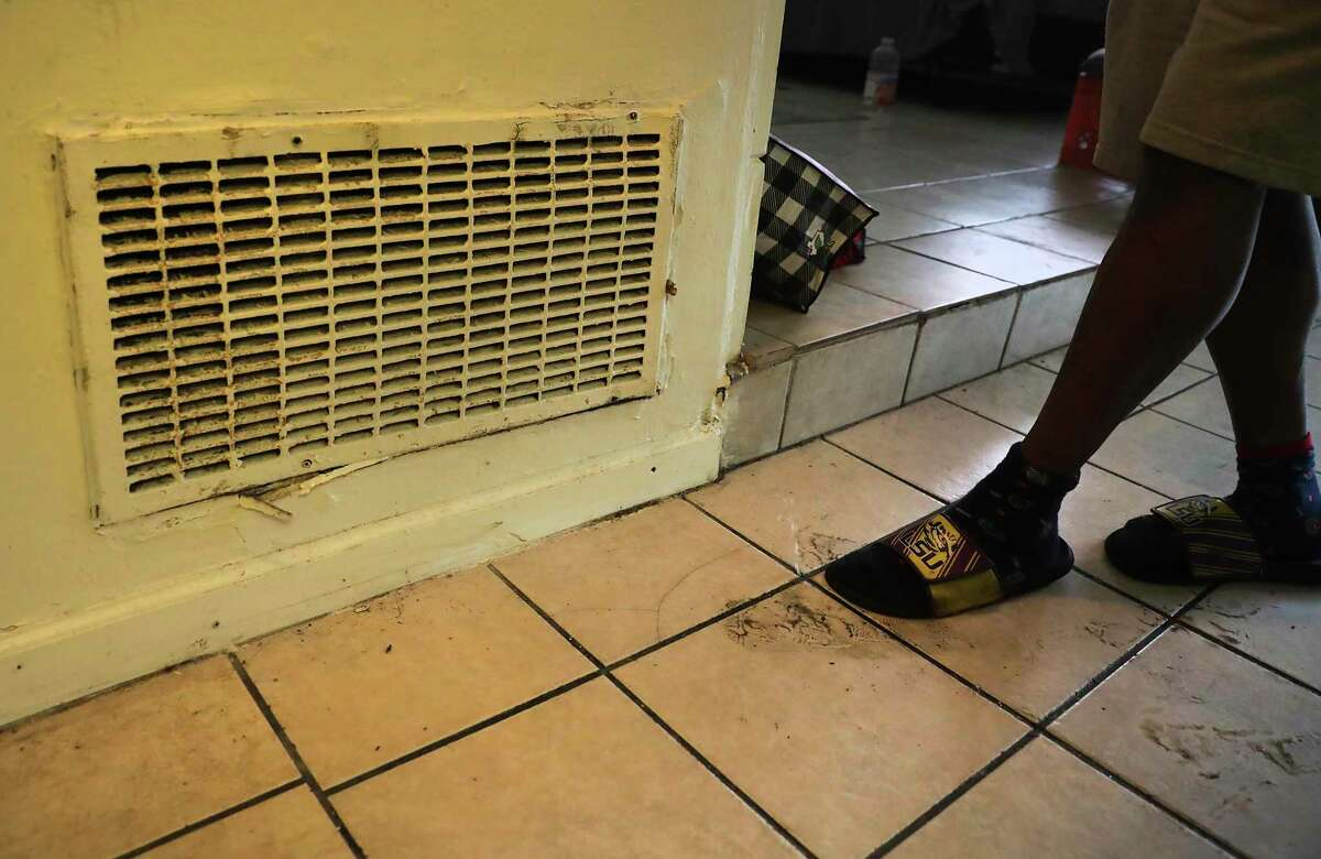 Alvin Brown, a renter at Spanish Oaks Apartments which is owned by Trif, has received a notice to vacate, on Tuesday, April 21, 2020. Brown presses his foot to show where water is coming out of the floor.