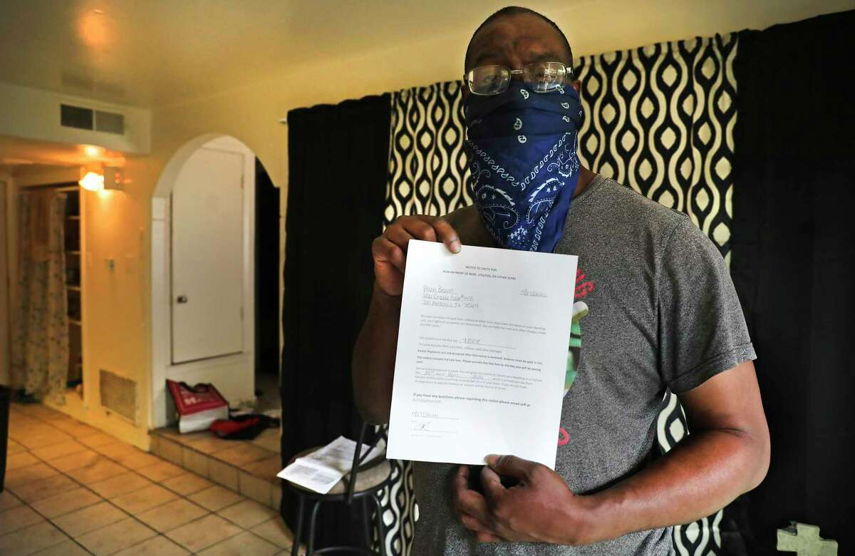 Alvin Brown, a renter at Spanish Oaks Apartments that is owned by Trif, has received a notice to vacate. Brown holds some of the paperwork he has received. A proposed ordinance, which was rejected last week, would have required landlords to give tenants 60 days' notice to any proposed evictions, to give those tenants a chance to cure any rent delinquencies.