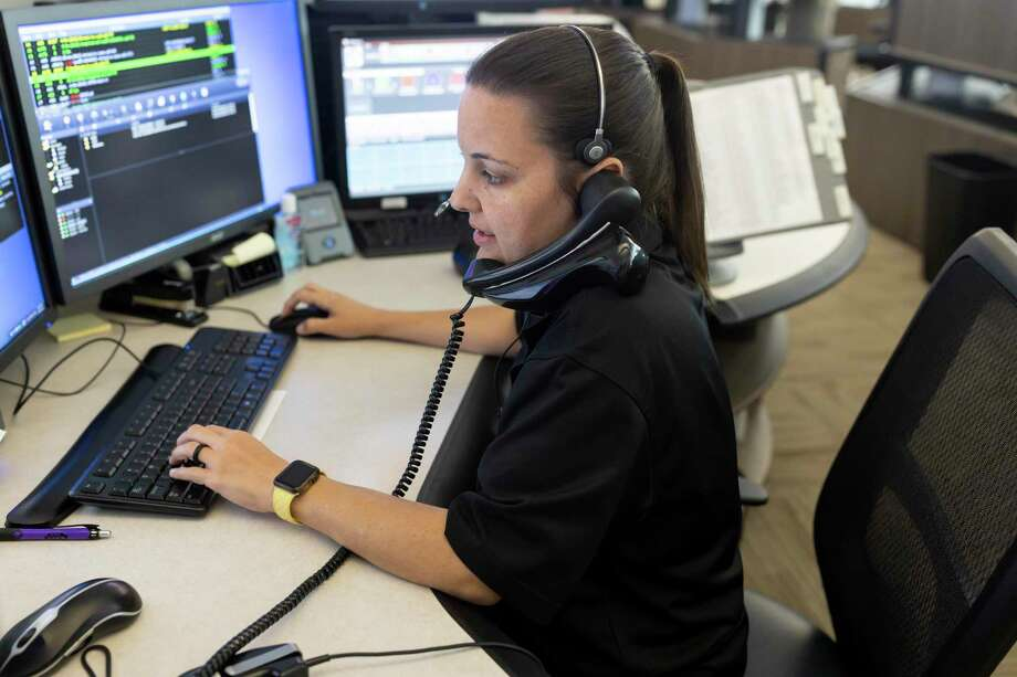 Heather Silvio, dispatch center supervisor, takes a phone call at the Conroe PD dispatch office, Thursday, April 30, 2020. Photo: Gustavo Huerta, Houston Chronicle / Staff Photographer / Houston Chronicle © 2020