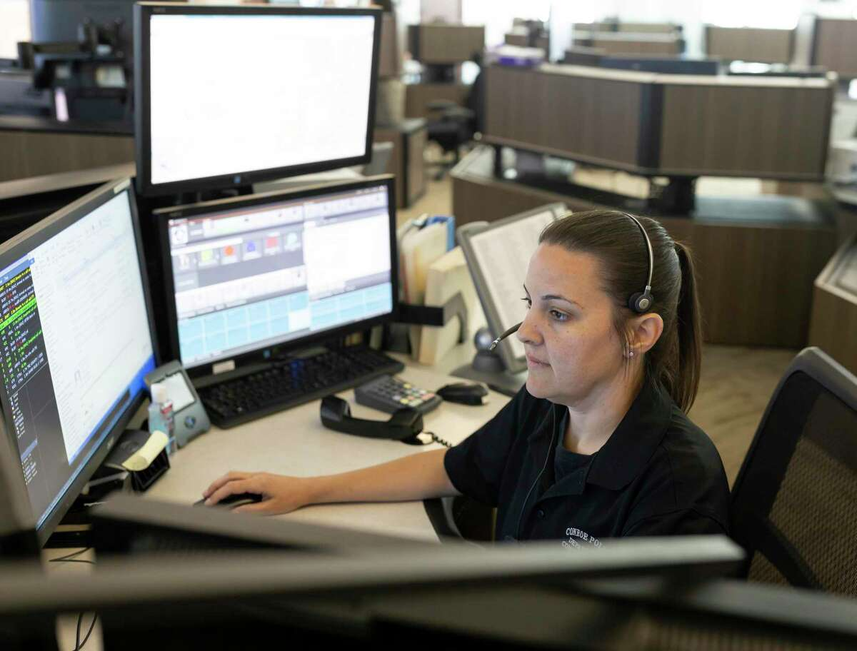 Heather Silvio, dispatch center supervisor, takes a phone call at the Conroe PD dispatch office, Thursday, April 30, 2020.