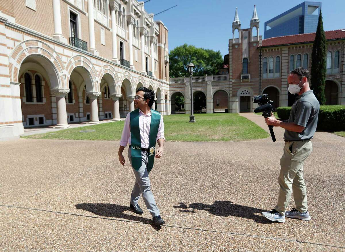 Brandon Martin, right, the manager of videography at Rice University, shoots video footage of Shree Kale, who will be graduating from the School of Architecture, on the Rice campus in Houston, Friday, May 1, 2020. Martin is helping film and orchestrate the private Houston university's virtual commencement, which will be held on May 16. Rice officials are planning to stream a pre-recorded feature-length-style video that will include college officials naming each graduate, student profiles, essays, comments from President David Leebron and faculty and staff. Kale, was chosen to be video taped because of an essay that he wrote.