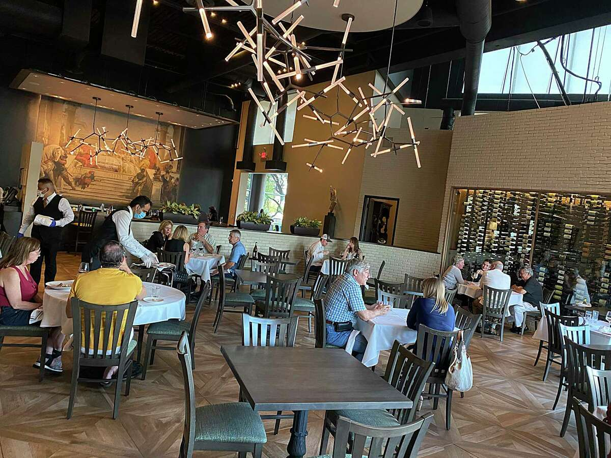 Tables with tablecloths were the ones open to customers to conform with the new 25 percent rule at Aldo's Ristorante Italiano. By 7 p.m., it was full.