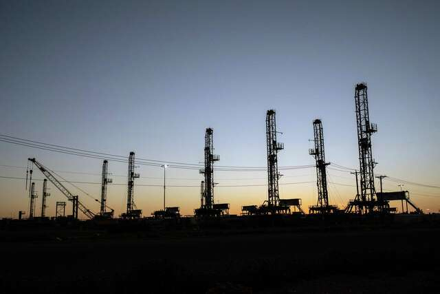 Unused oil drilling rigs are stored in Odessa, Texas, on April 24, 2020.
