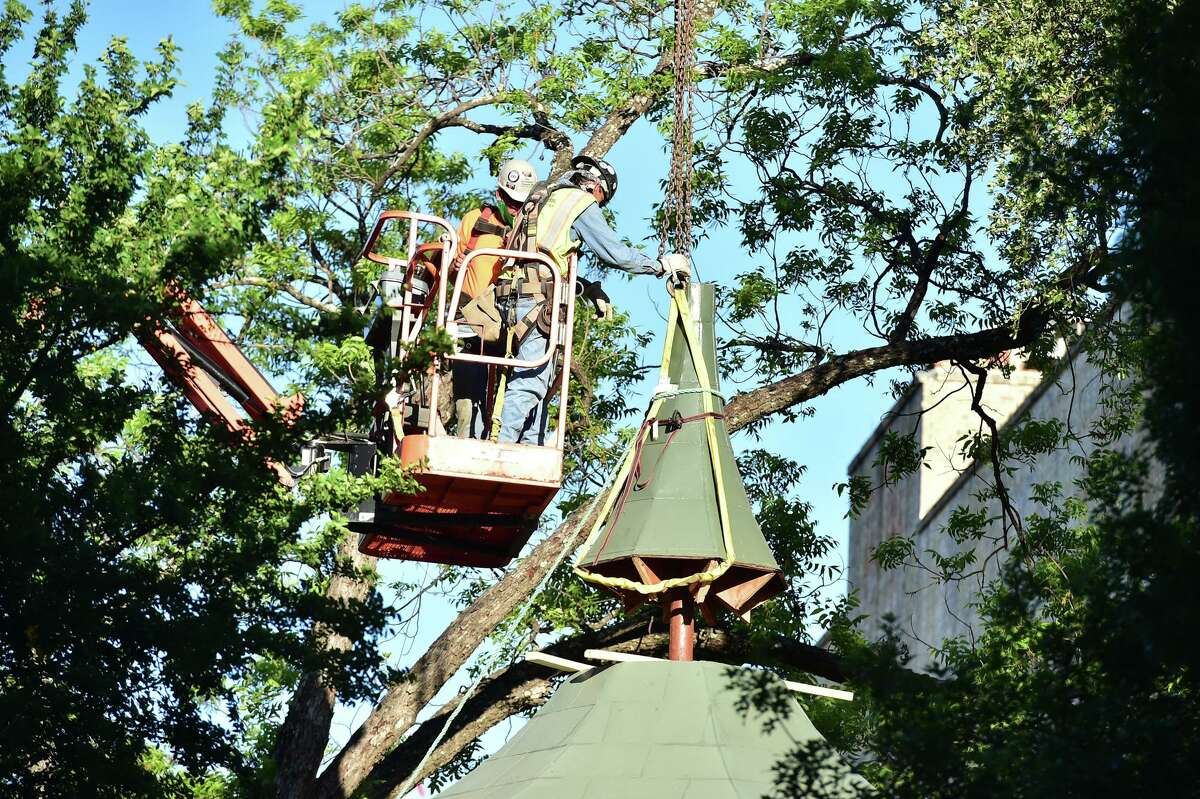 Workers disassemble the 1970's bandstand in Alamo Plaza on May 1. The city is developing a plan to rebuild the bandstand, which now is in storage, at a new park by the historic Hays Street Bridge on the East Side.