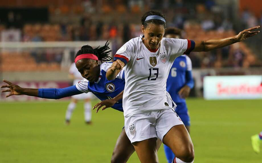 The United States forward Alex Morgan (13) battles with Haiti defender Ruthny Mathurin (4) during the first half of the CONCACAF Women's Olympic Qualifying Tournament match Tuesday, Jan. 28, 2020, at BBVA Stadium in Houston. Photo: Yi-Chin Lee / Staff Photographer