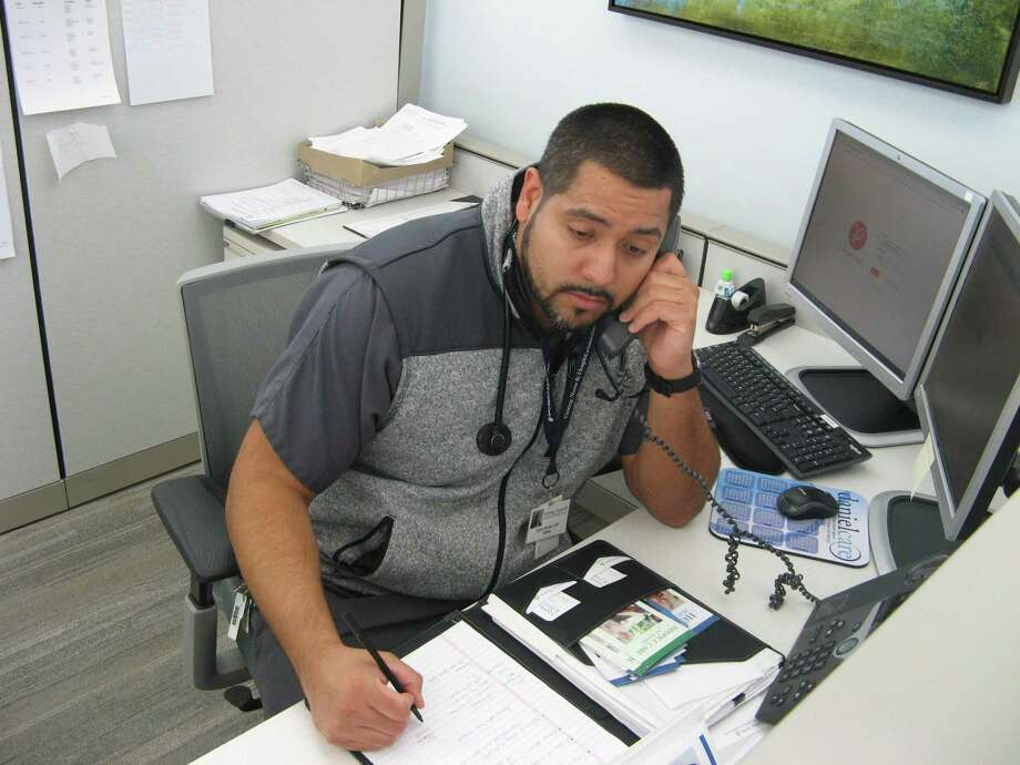 Carlos Alvarez, a nurse with Visiting Nurse & Hospice of Fairfield County, takes a call from a member of the community on April 1, 2020, as the nursing agency in Wilton, Conn., opens its Ask A Nurse hotline. Photo: Contributed Photo / Visiting Nurse & Hospice / Wilton Bulletin Contributed