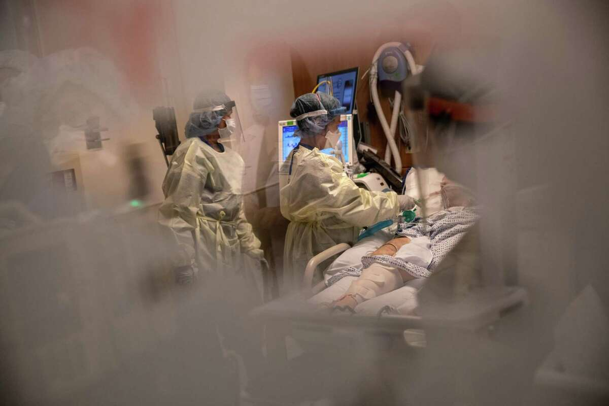 Nurses tend to a COVID-19 patient in a Stamford Hospital intensive care unit, on April 24, 2020 in Stamford, Connecticut. Stamford Hospital.