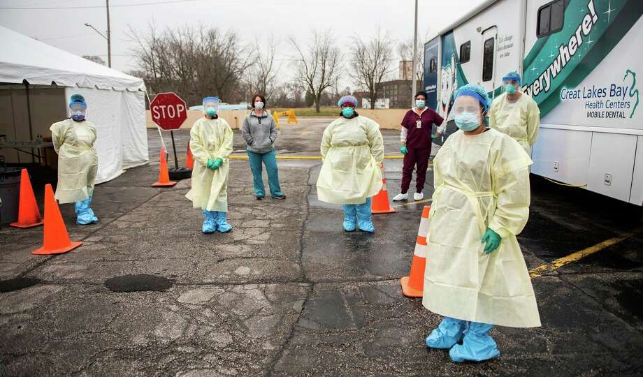 Smriti Pant and other members of the team operate the Great Lakes Bay Health Centers COVID-19 sampling site in downtown Saginaw on Tuesday, April 7.(Photo provided/Michael Randolph, SVSU)
