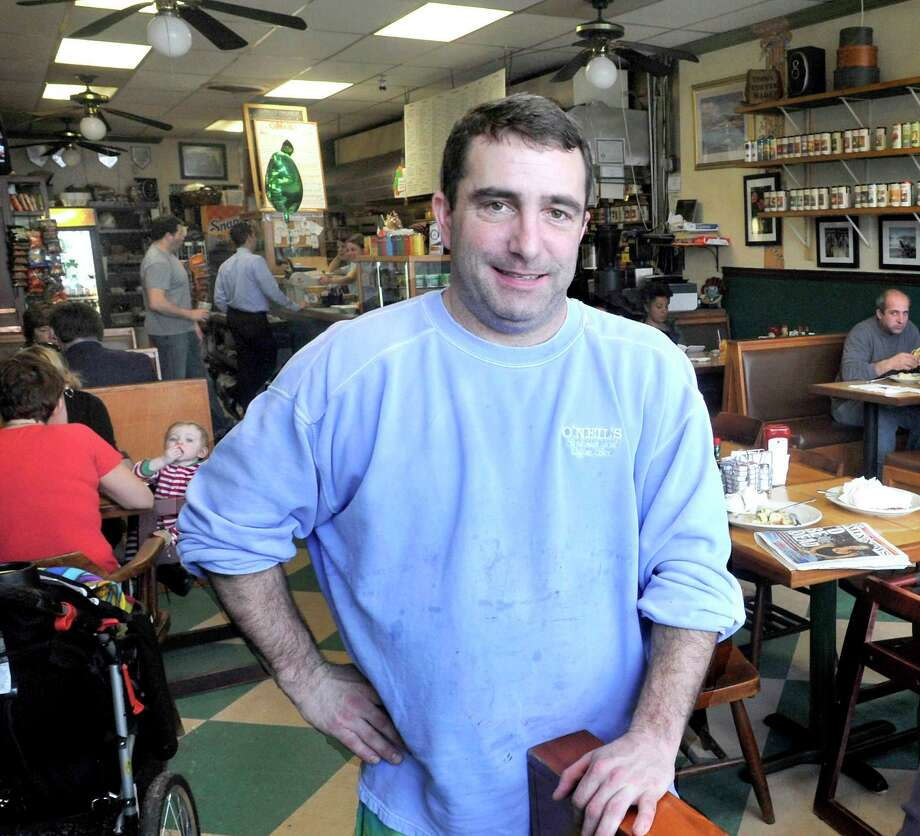 Patrick O'Neil stands inside Patrick O'Neil's Sandwich & Coffee Bar in Bethel. Photo: File Photo / The News-Times