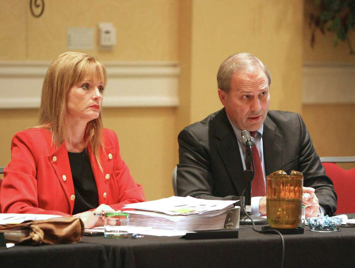 Nelda Luce Blair, left, and Don Norrell listen to resident's concerns during The Woodlands Township's town hall meeting Wednesday night at the Waterway Marriott in 2013. Blair called into the public comment of the Aug. 26, 2020, meeting to heap praise on Norrell for his 14 years of work with the township. Norrell's last day of work is Sept. 5.