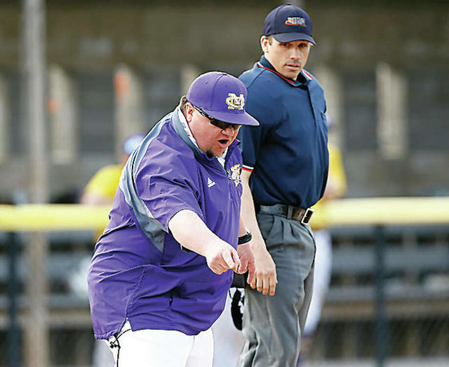 Civic Memorial baseball coach Nick Smith argues with home plate umpire in a 2018 game just before getting ejected against Alton at the Bethalto Sports Complex. Smith, who was arguing a fair ball call in the Eagles' 7-6 victory, is coping with a lost season in 2020. Photo: Billy Hurst / Telegraph File Photo
