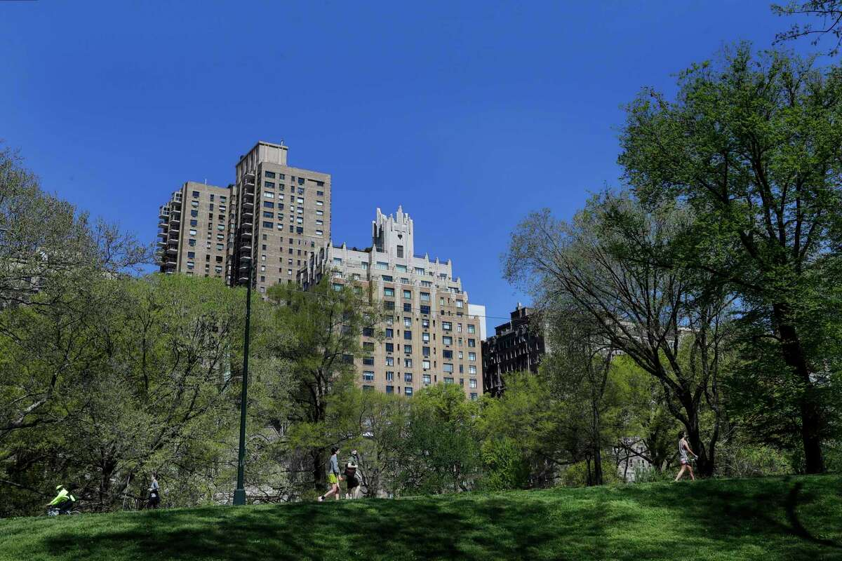 People enjoy Central Park on a sunny day during the coronavirus pandemic Saturday, May 2, 2020, in New York.