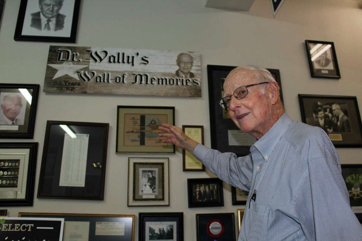 """Dr. Walter """"Wally"""" Wilkerson displays a wall of memories in the Montgomery County Republican Party headquarters."""