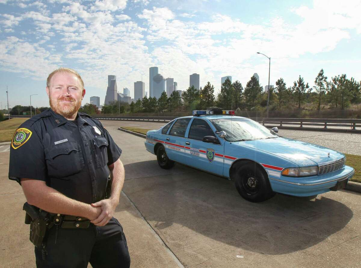 Fallen officer Jason Knox pictured in Nov. 21, 2018 file photo with a restored 1996 Chevrolet Caprice HPD cruiser in Houston.