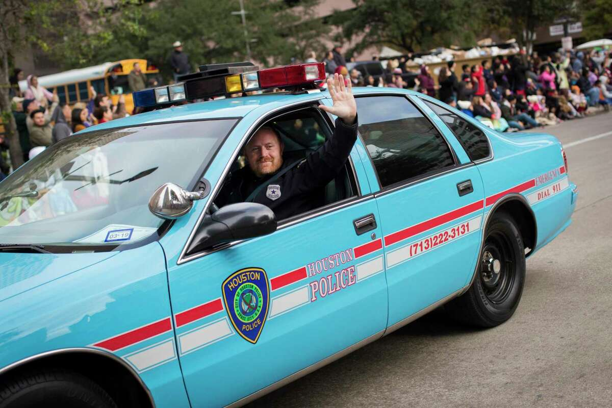 Fallen officer Jason Knox pictured in a Nov. 22, 2018 file photo at the H-E-B Thanksgiving Day Parade in a restored 1996 Chevrolet Caprice HPD cruiser.