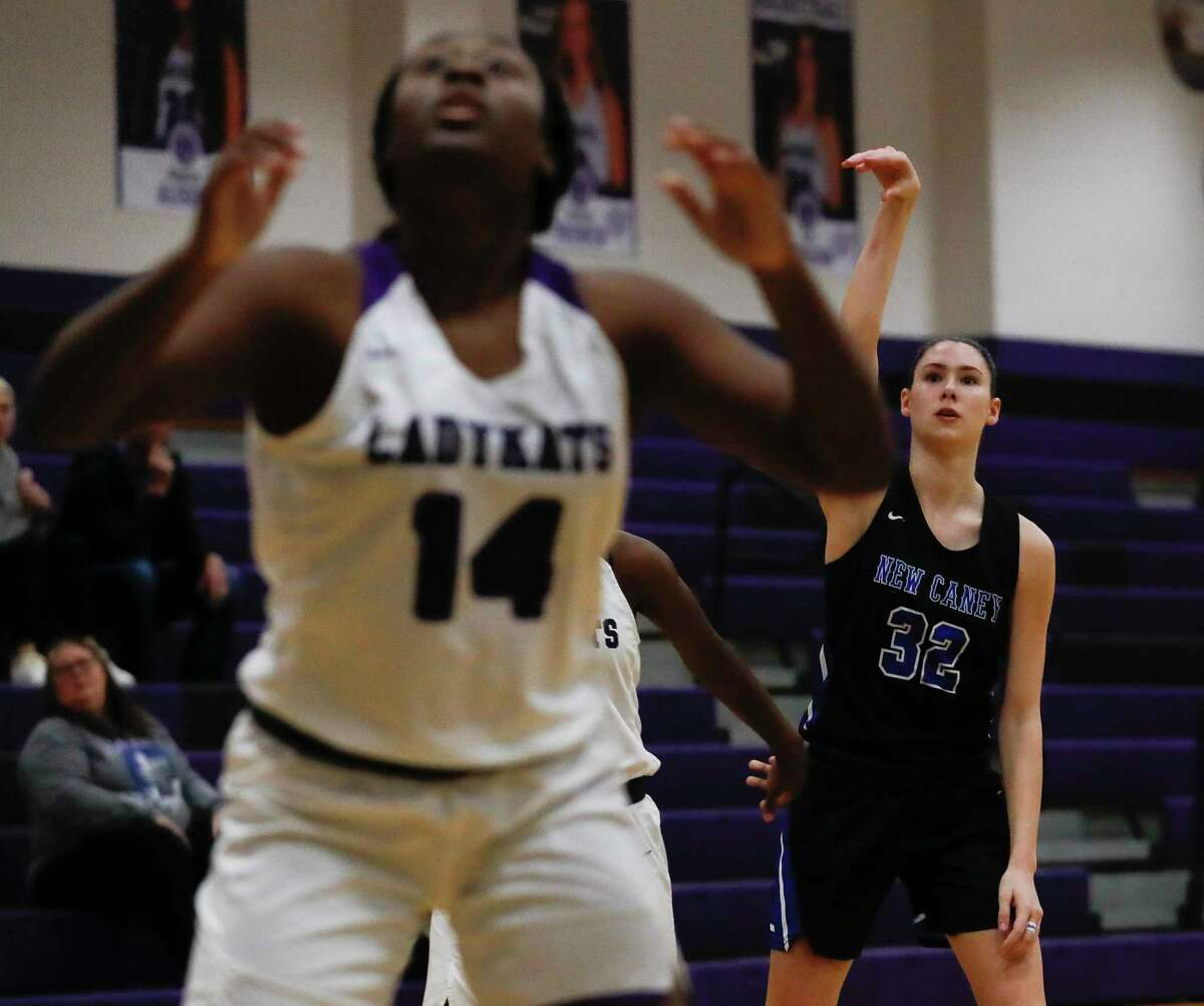 New Caney power forward Tori Garza (32) watches as her 3-pointer hits during the third quarter of a District 20-5A high school basketball game at Willis High School, Tuesday, Jan. 14, 2020, in Willis.