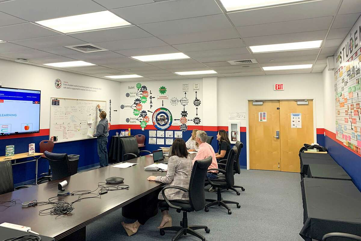 """Manteca Unified Superintendent Clark Burke works with staff in his district office """"war room"""" to develop plans for reopening."""