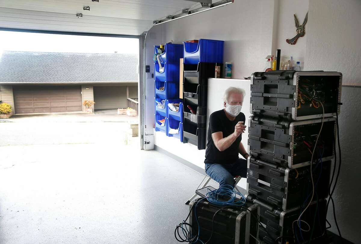 Audio engineer Alfred Tetzner calibrates recording equipment stored in his garage while he shelters in place during the coronavirus pandemic in Pacifica, Calif. on Saturday, May 2, 2020.