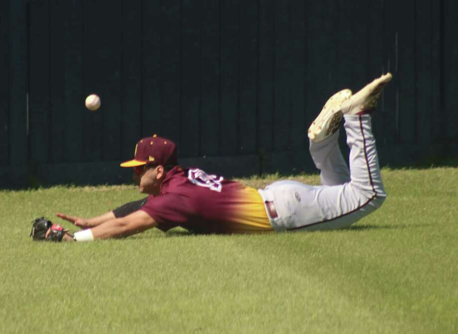 It was efforts like this Anthony Solano diving attempt to snag a foul ball that contributed to Deer Park winning the 2020 hypothetical district baseball title. Photo: Robert Avery