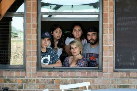 The family of Luz María Ortíz de Pulido of Del Valle, shown with her husband, Valentine Pulido, and three of their kids, was among those not eligible for aid from the coronavirus relief package.