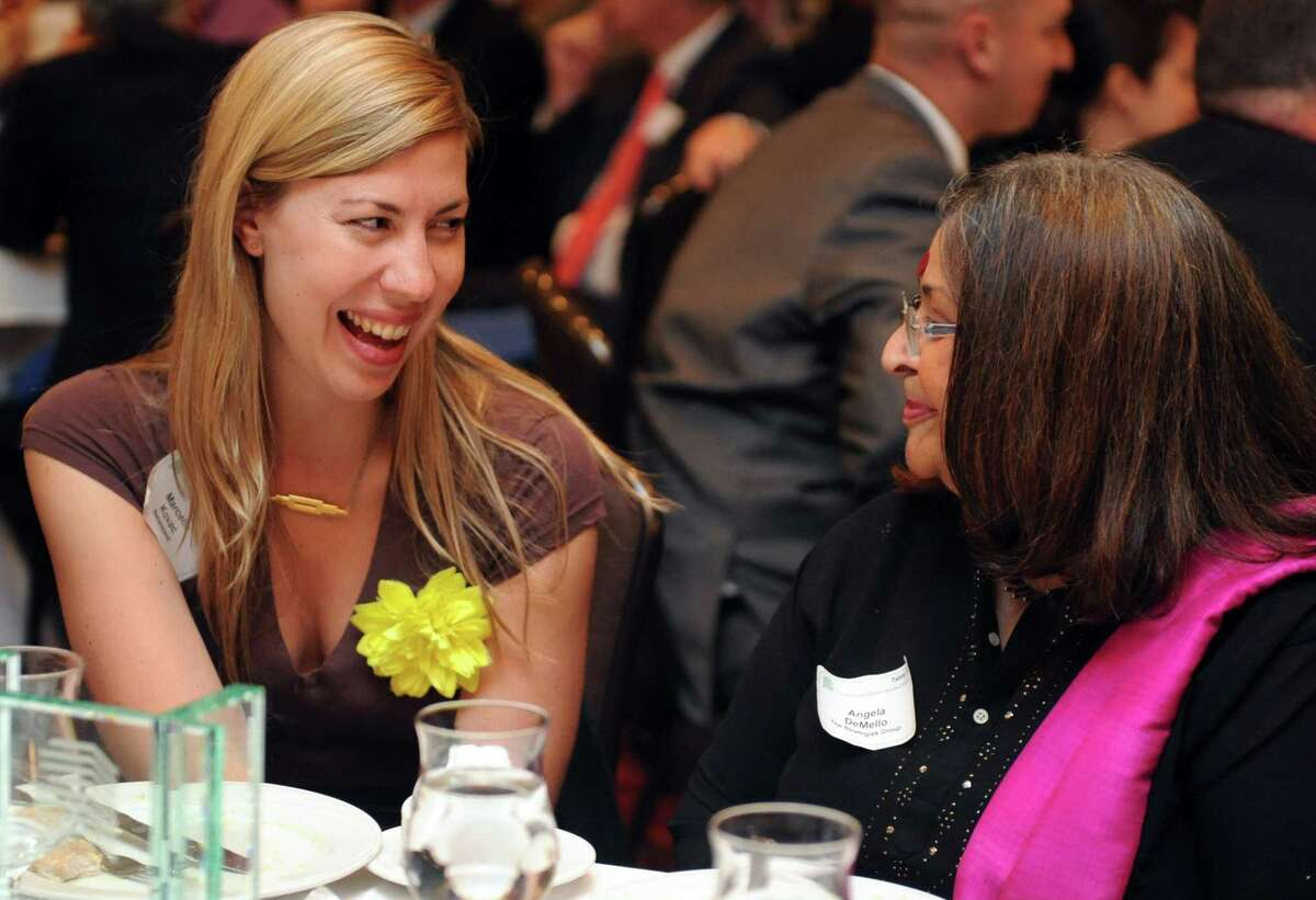 Marcella Kovac talks with Angela DeMello during the Bridgeport Regional Business Council's Annual Meeting and Luncheon Tuesday June 1, 2014.