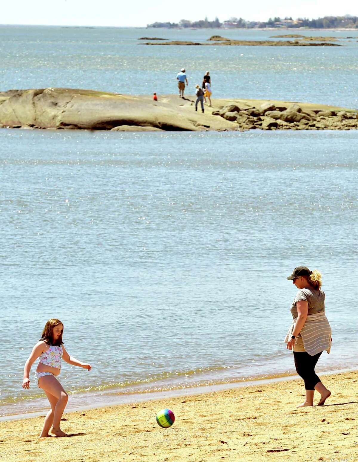 Madison, Connecticut, Saturday, May 1, 2020: People enjoy the warmth and sunshine Saturday at the Surf Club town beach in Madison during the Covid-19 / Coronavirus pandemic.
