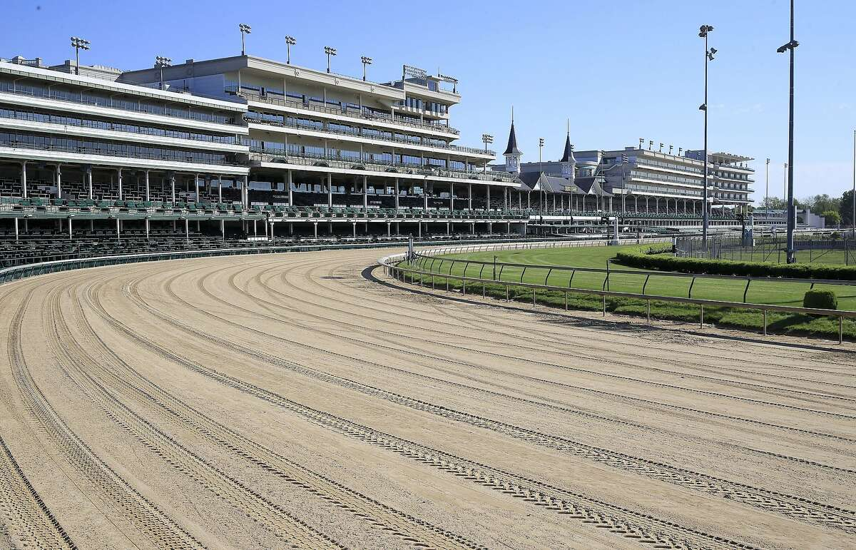 """A view of the twin spires and empty grandstand from the first turn at Churchill Downs on May 02, 2020 in Louisville, Kentucky. Then there's Kentucky, where there are hundreds of unfilled appointments in many vaccine sites. """"The demand is just, we can already see it dwindling,"""" one local expert said."""