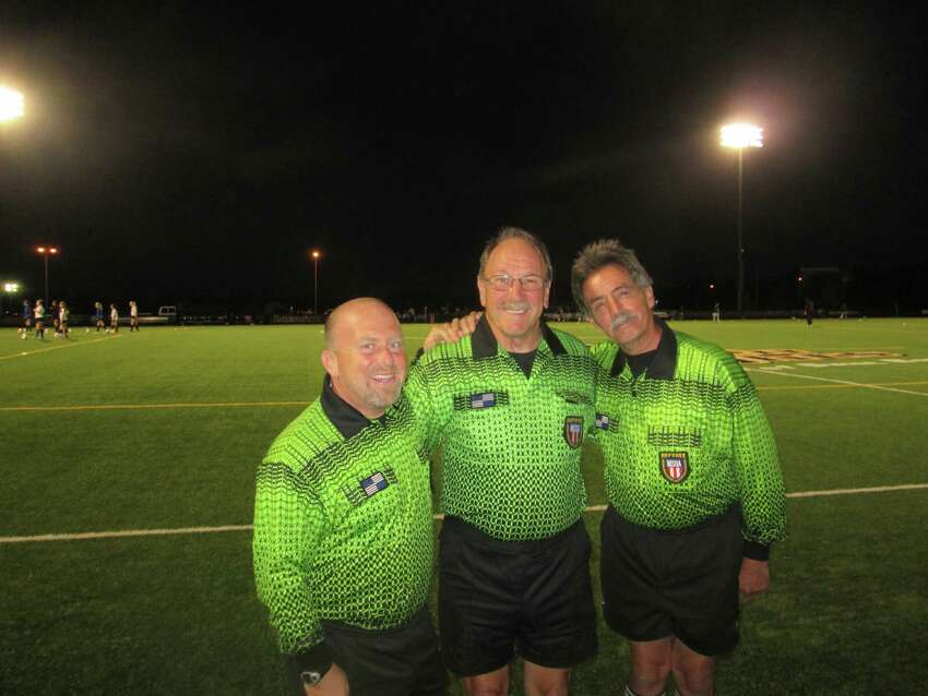 Referees, from left, Aaron Corman, Neil Riddell and Ronald Clark pose before a soccer match. (Provided)