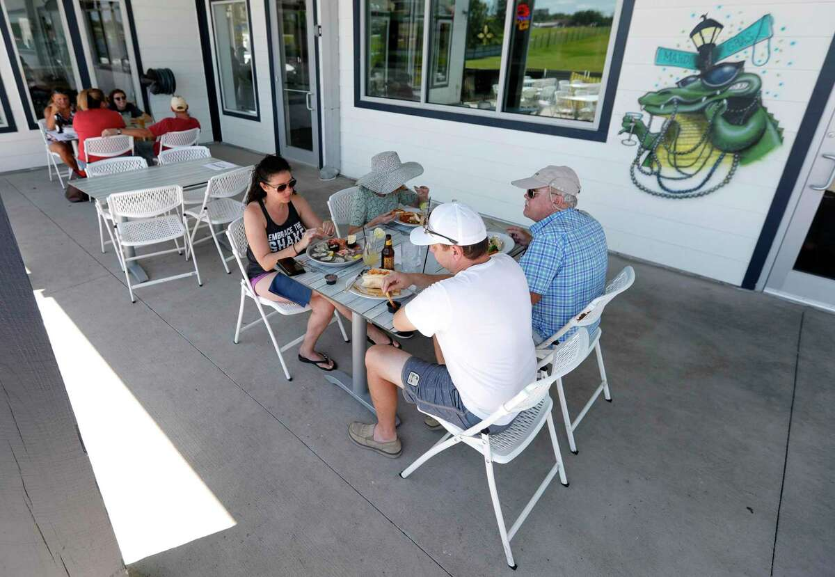 Denise and James Fiore enjoy lunch with family at Monty's Lighthouse Cajun Bar & Grill, Saturday, May 2, 2020, in Montgomery. Restaurants around Montgomery County were able to reopen at 25 percent capacity after Gov. Greg Abbott's executive order ended Thursday.