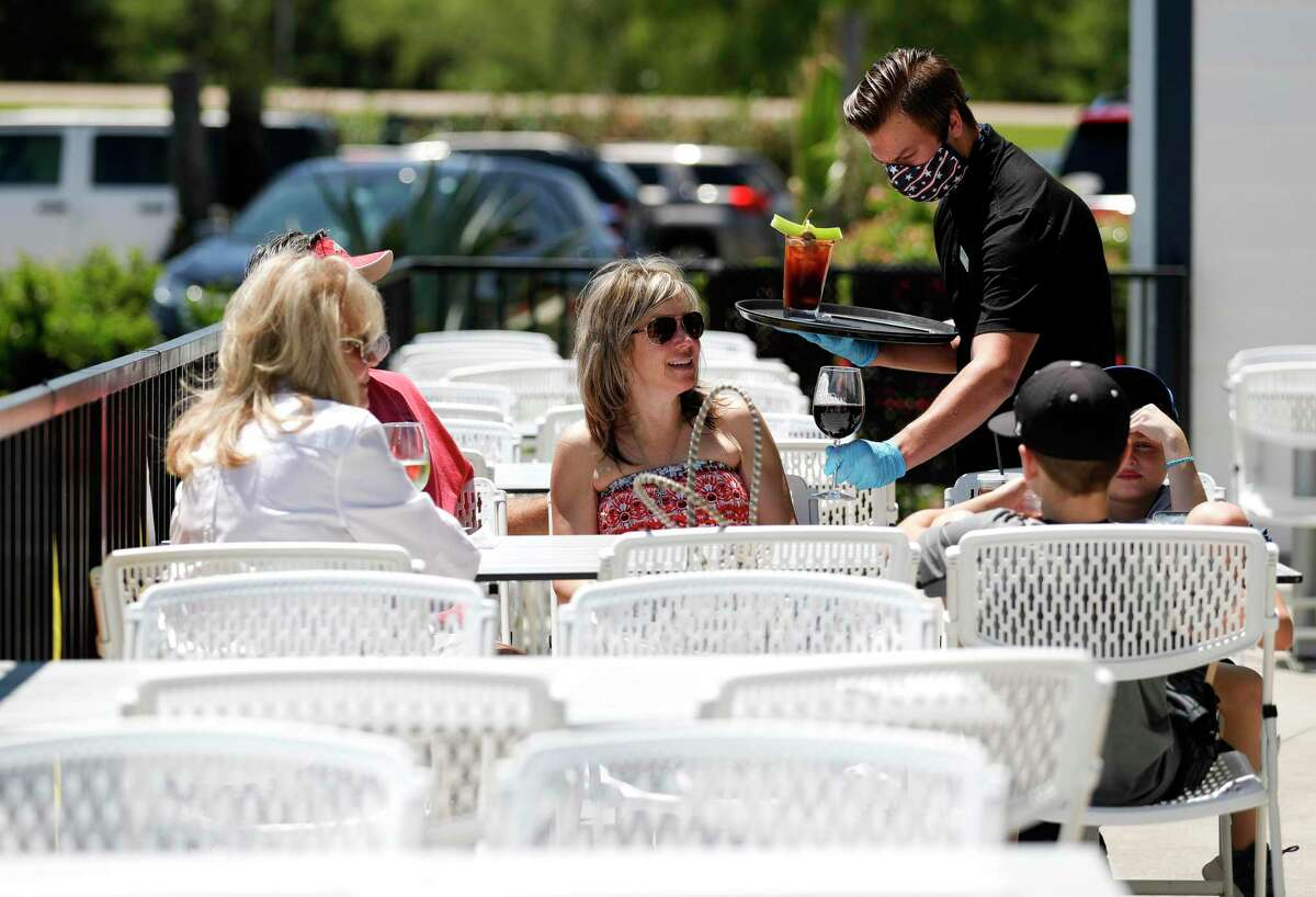 The Karnauch family enjoys the weather on the patio at Monty's Lighthouse Cajun Bar & Grill, Saturday, May 2, 2020, in Montgomery. Restaurants around Montgomery County were able to reopen at 25 percent capacity after Gov. Greg Abbott's executive order ended Thursday.