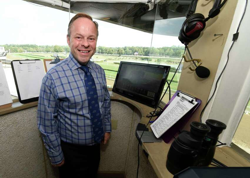 Track announcer Larry Collmus in his office Monday afternoon Aug. 31, 2015 at the Saratoga Race Course in Saratoga Springs, N.Y. (Skip Dickstein/Times Union)