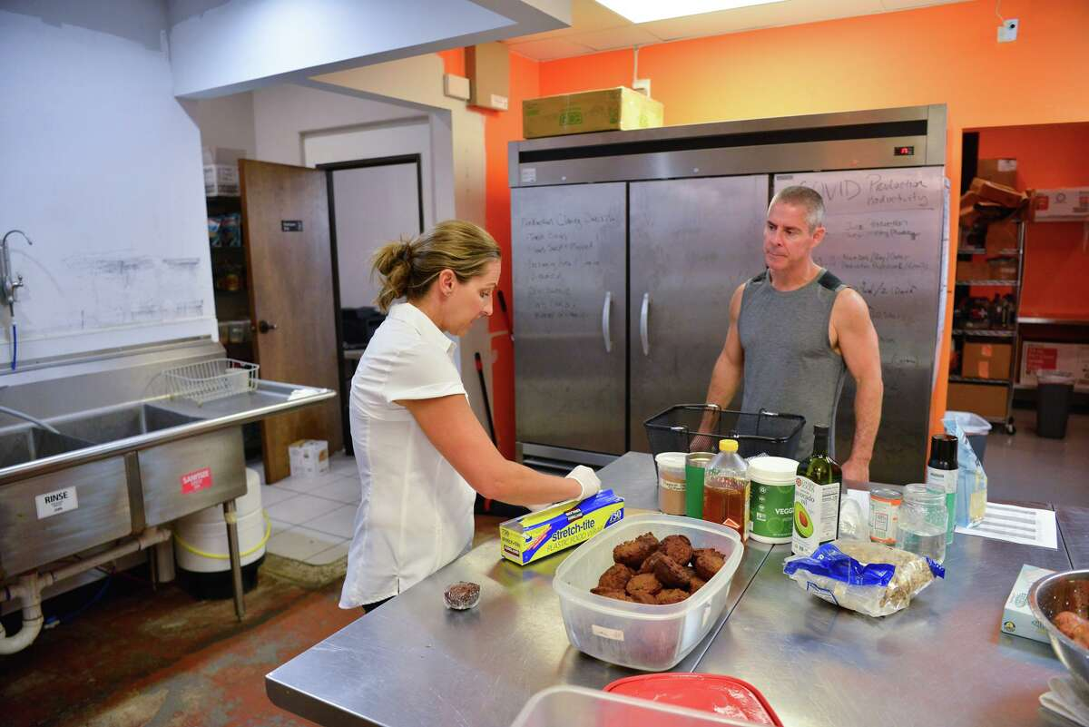 Sarah Treat, owner of Local Health Market works in her store Saturday with husband Jason. She said she has lost half of her business and had to lay off employee's since the pandemic.