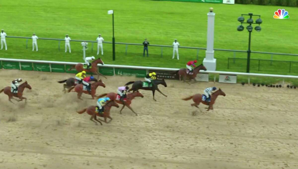 In this image taken from video provided by NBC Sports, Secretariat, right, crosses the finish line to win a computer-simulated version of the Kentucky Derby horse race between the 13 winners of the Triple Crown, Saturday, May 2, 2020, in Louisville, Ky. The race was part of NBC's substitute programming after the Kentucky Derby was postponed by the coronavirus pandemic. (NBC Sports via AP)