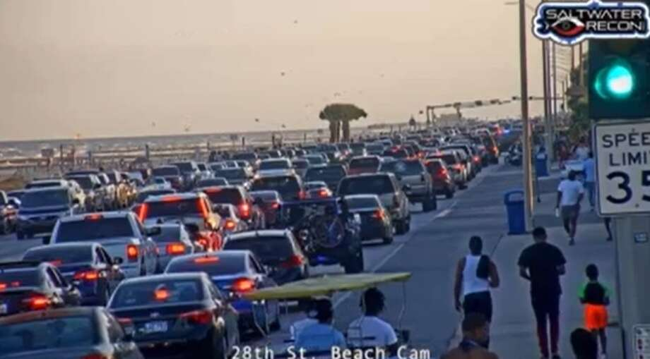 A screengrab of a video from Saltwater Recon shows heavy traffic along the Galveston Seawall on Saturday, May 2, a day after beaches reopened along the Texas coast. Photo: Saltwater Recon