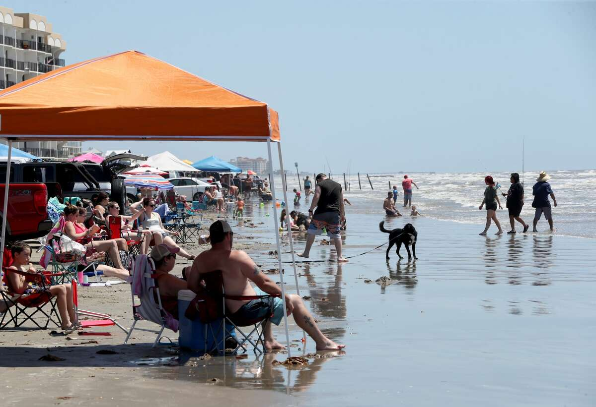 Beachgoers line the water's edge at Hershey Beach in Galveston on Saturday, May 2, 2020. Thousands of people flocked to the island's beaches that reopened Friday after being closed March 29 in response to the COVID-19 pandemic.